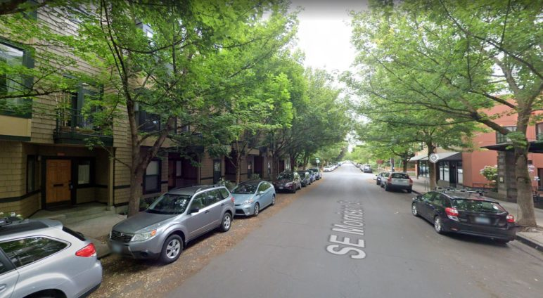 image of tree-lined street with townhomes